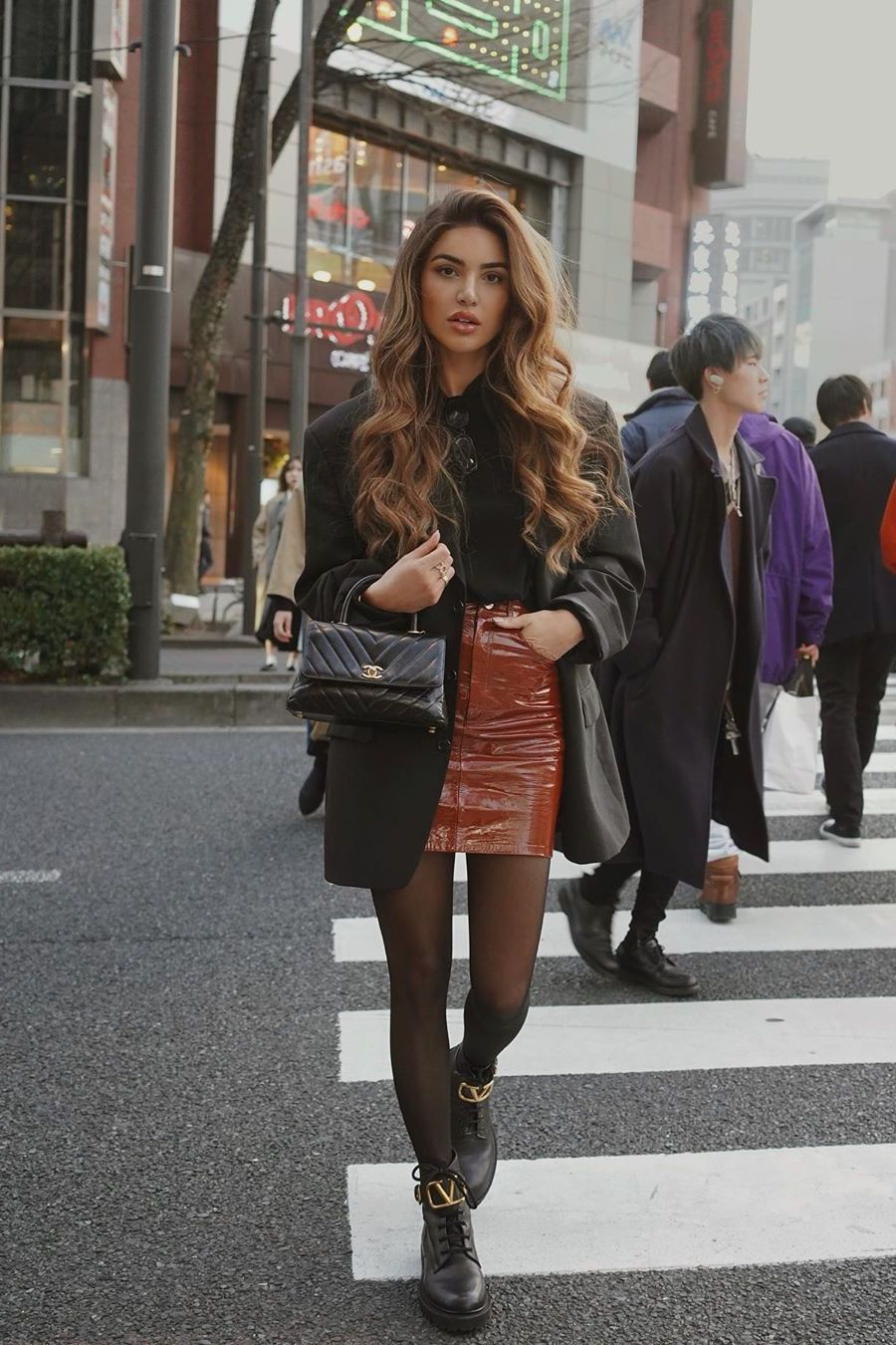 Black oversized blazer with brown mini skirt and low boots