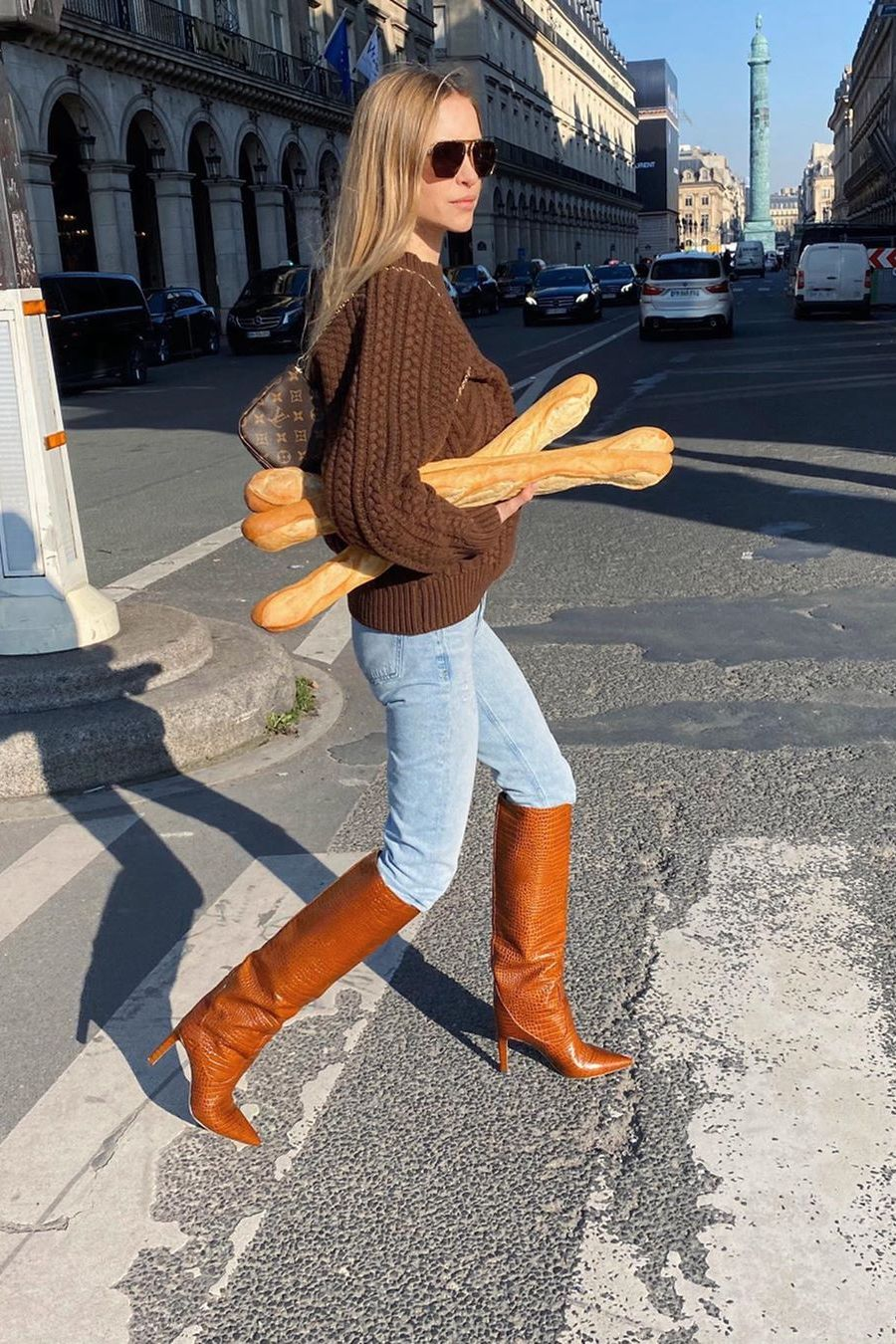 pernille teisbaek wearing jeans and brown cable-knit sweater