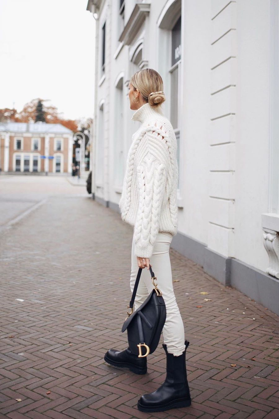 white cable-knit sweater with white jeans