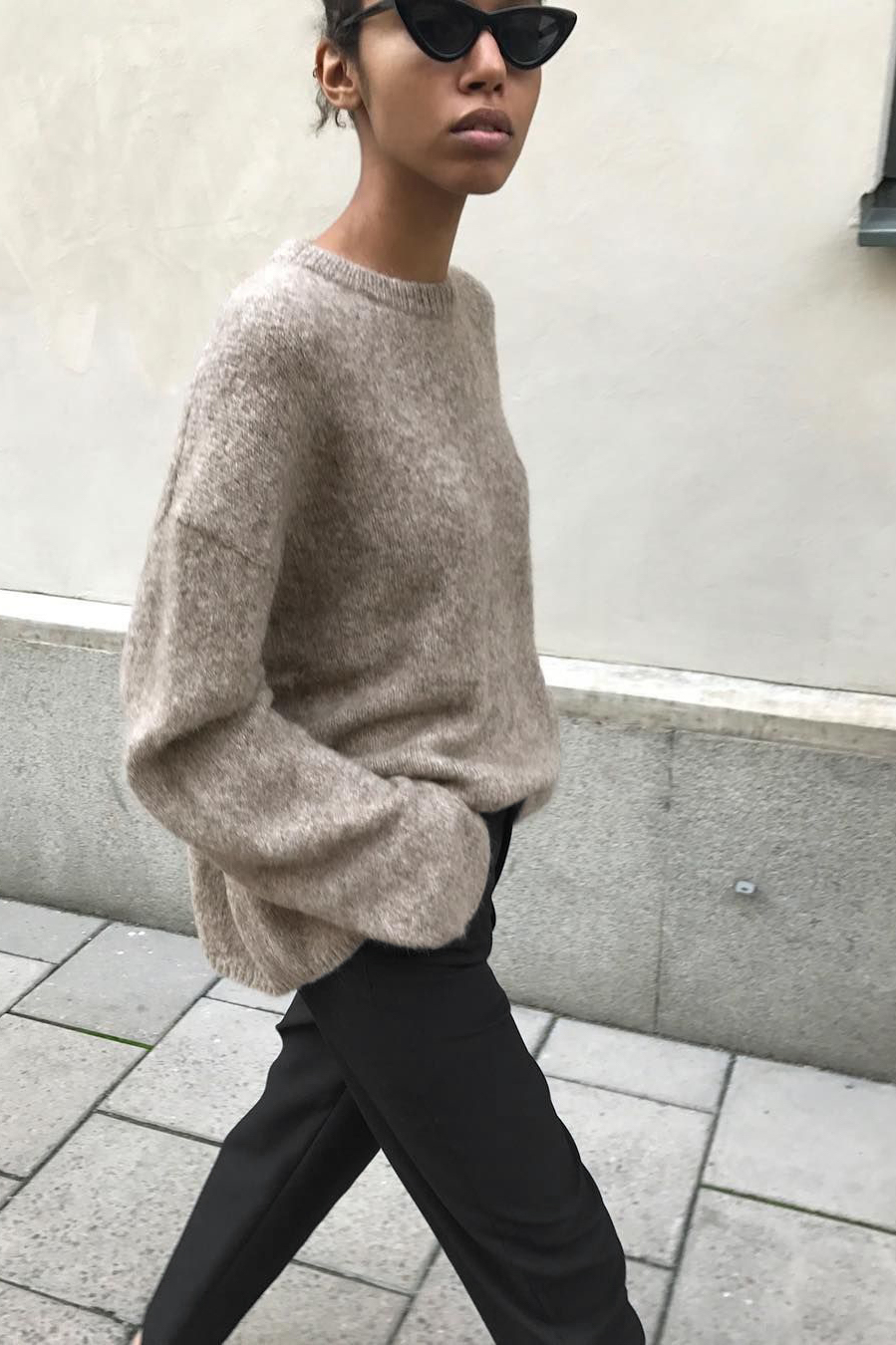 Black Trousers with beige sweater minimalist outfit