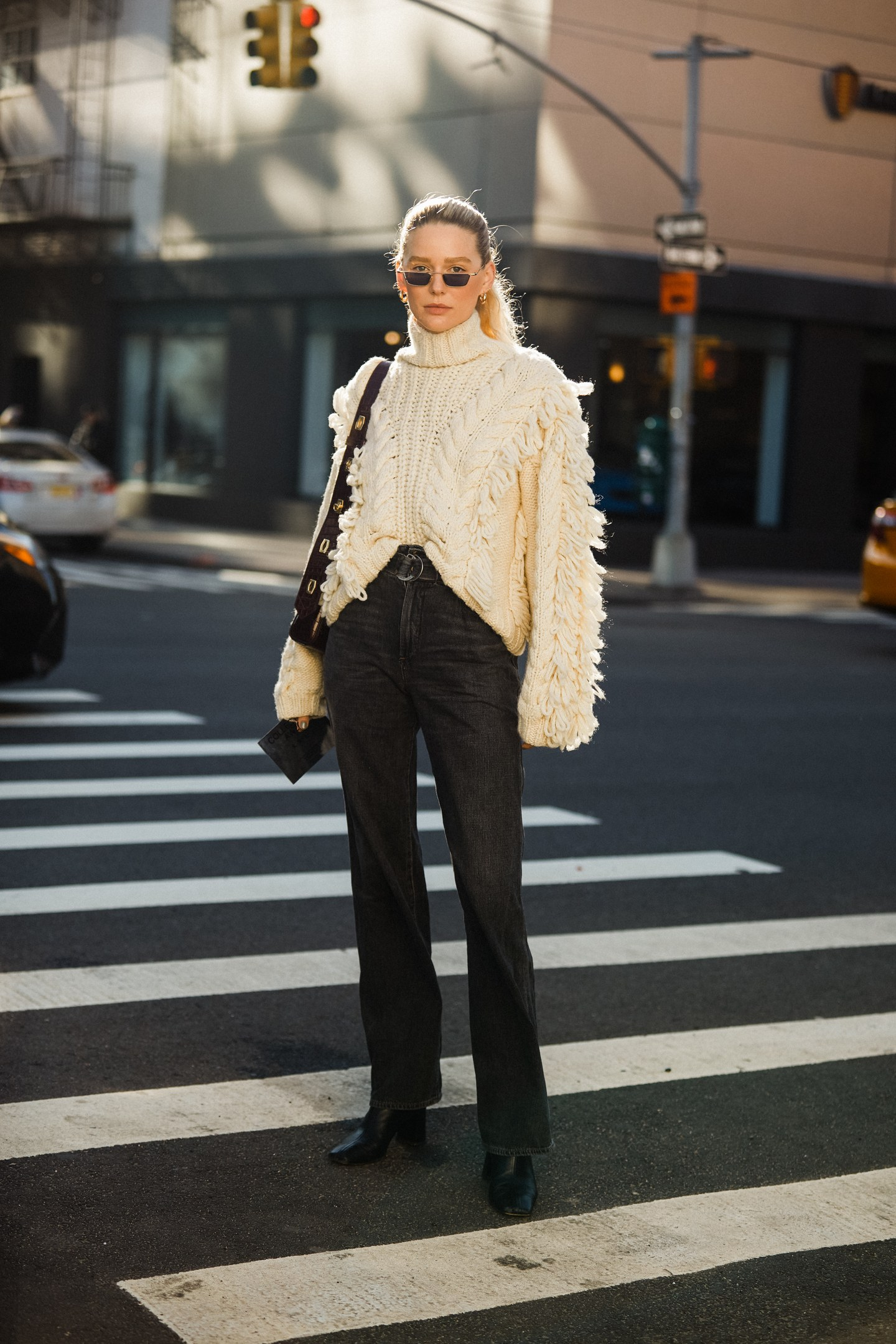 cable-knit sweater with black jeans outfit