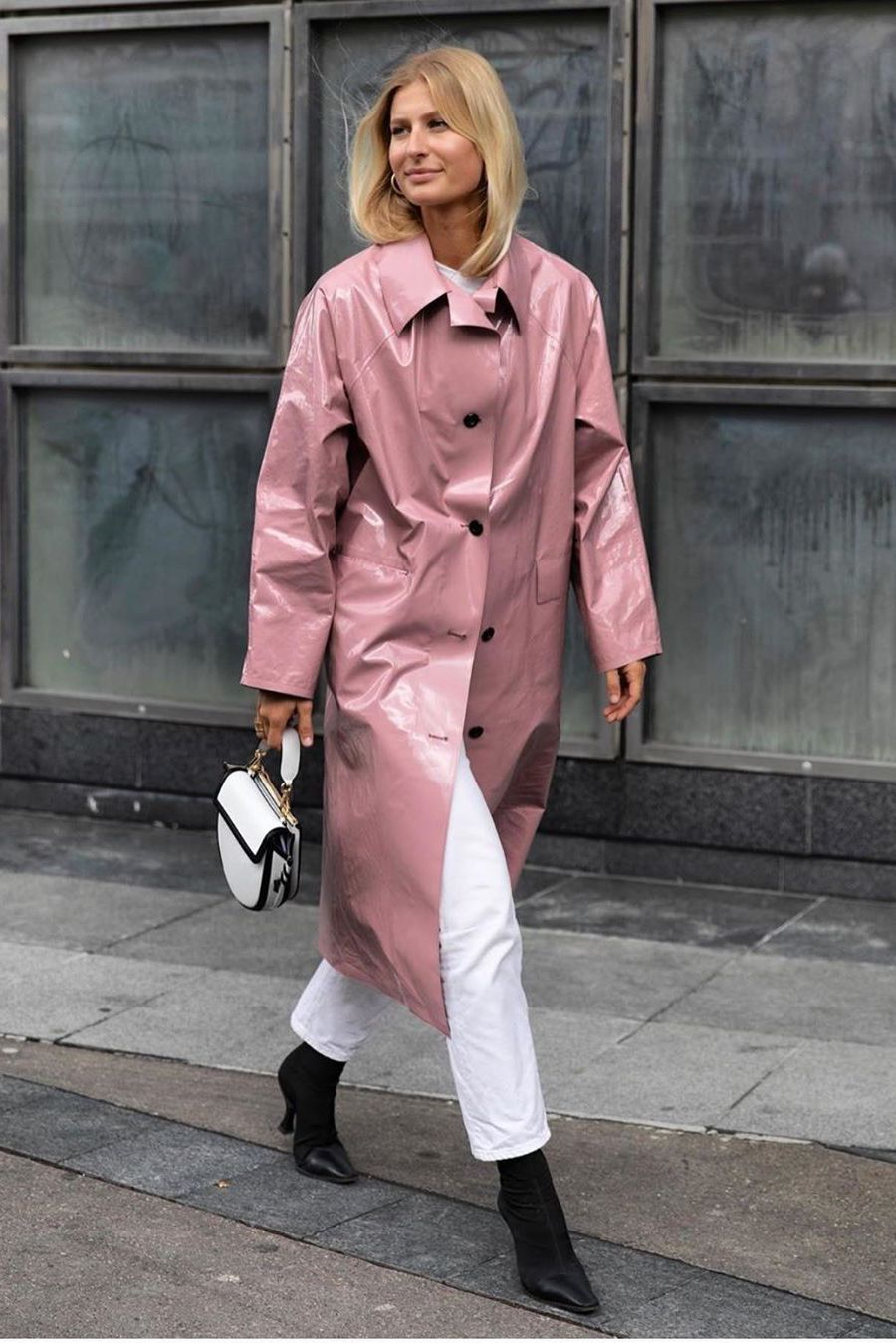 Pink trench coat with white jeans and black boots