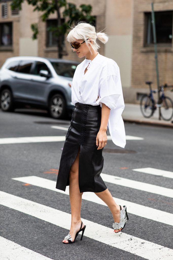 White oversized button down shirt with leather skirt